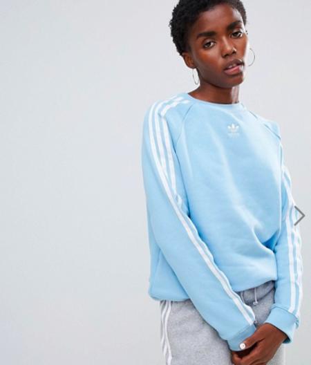 Diego Ricol recomienda: Esta sudadera Adidas Original con las clásicas bandas laterales tiene 20% de descuento y envío gratis en ASOS